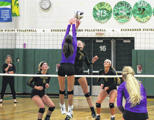 Alexis Sarvo of Swanton and Nicole Brand of Evergreen (1) meet at the net during Tuesday's NWOAL opener. After letting the first set slip away, the Vikings rebounded to take the next three for a four-set victory.