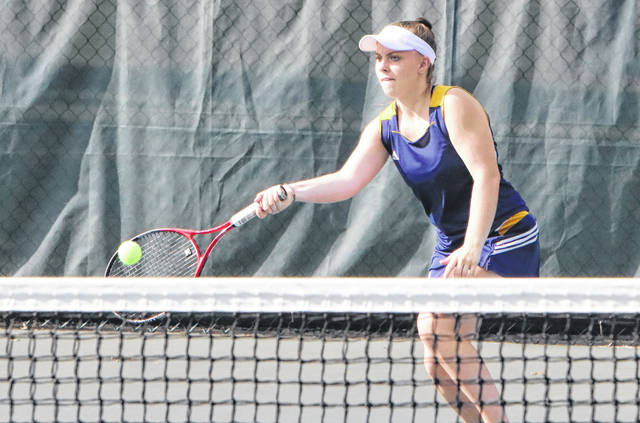 Amanda Payne of Archbold returns a ball during Thursday's match at Wauseon. She won her match against Alisa Shelt, helping lead the Bluestreaks over the Indians.