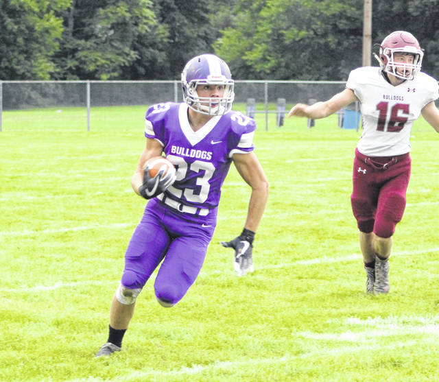 Swanton's Michael Lawniczak finds open space against Rossford during the season opener on Friday.