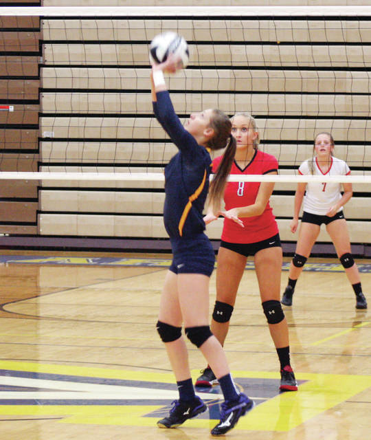 Archbold's Gabby Nafziger sets one during a league game versus rival Wauseon last season. She returns as the Bluestreaks' setter in 2018.