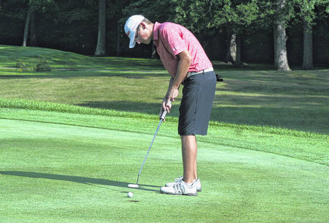 Eric Parker sinks a putt for Wauseon during Monday's match against Stryker. The Indians bested the Panthers 176-184.