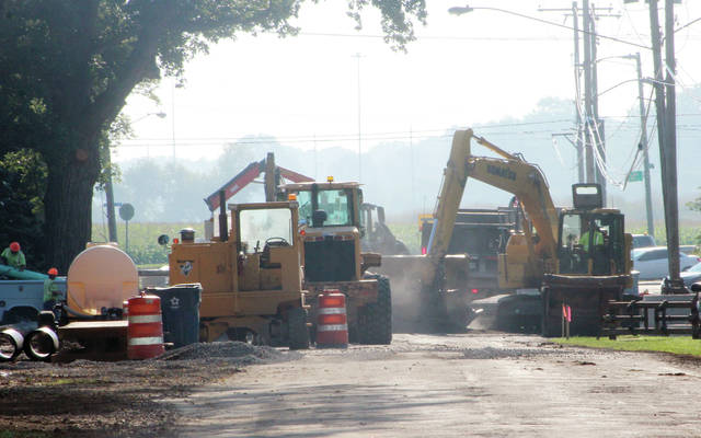 Work continues on the new storm sewer on Church Street in Swanton on Monday morning.