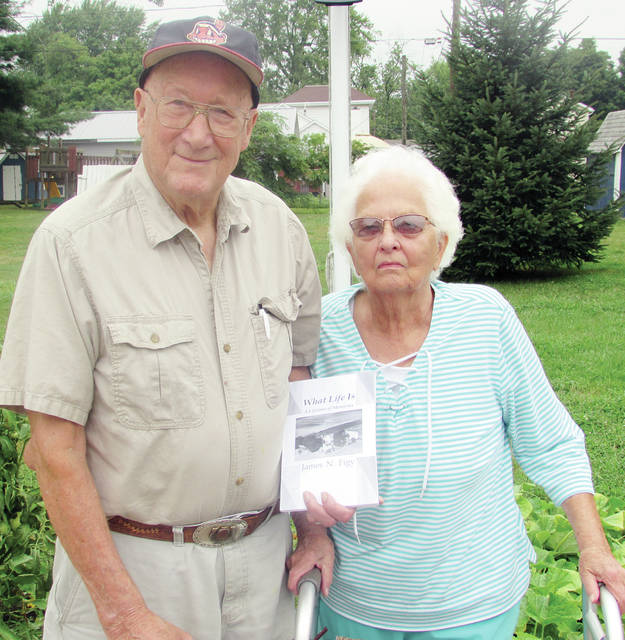 "Jim and Hazel Figy displaying his book, ""What Life Is: A Lifetime of Memories."" Figy will be featured at a book-signing Friday at the Museum of Fulton County."