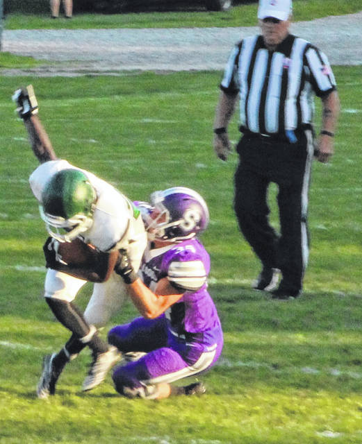 Ryan Marvin of Swanton brings down Teondre Patterson of Start.