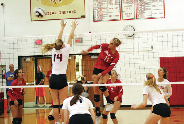 Lexi Sauber of Wauseon fires a shot from the middle for a kill in the third set of their NWOAL match with Liberty Center Thursday. The Indians bested the Tigers in three sets.