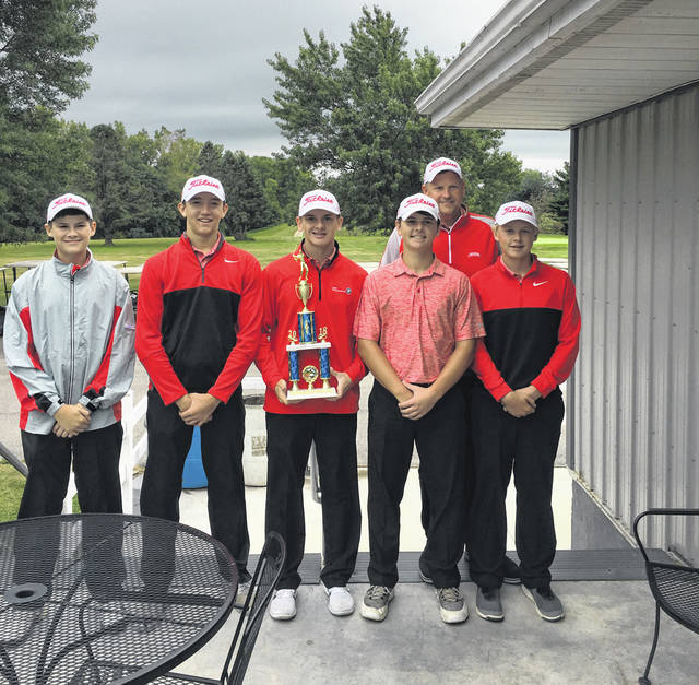Members of the Wauseon golf team pose with the championship trophy after winning the Stryker Invitational Saturday. As a group, they finished with a 323.